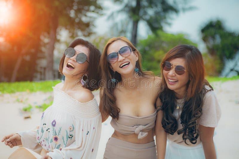 Three cheerful asian woman happiness emotion on vacation sea beach stock photo
