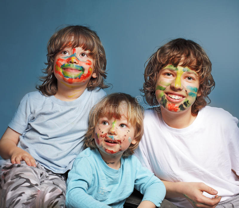 Three cheerful brothers stock images