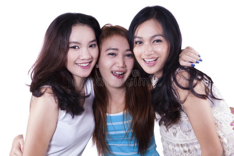 Three cheerful young girl friends stock images