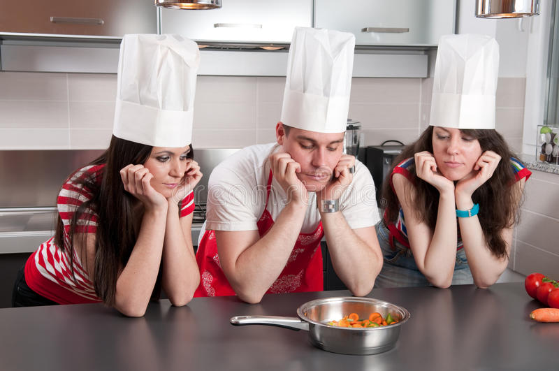 Download Three Chefs Staring At A Pan Of Carrots Royalty Free Stock Photo - Image: 23113845