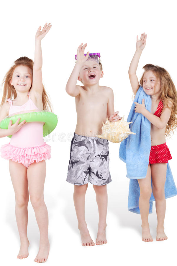 Download Three Children In Beach Suits With Beach Accessories Stock Photo - Image: 28968970