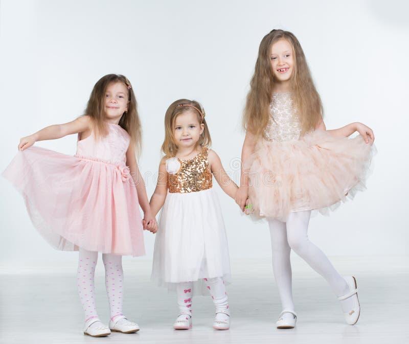 Three Children girl. In studio royalty free stock photography