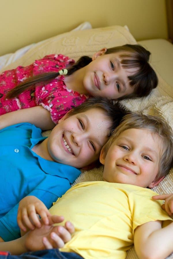 Three children having fun stock photography