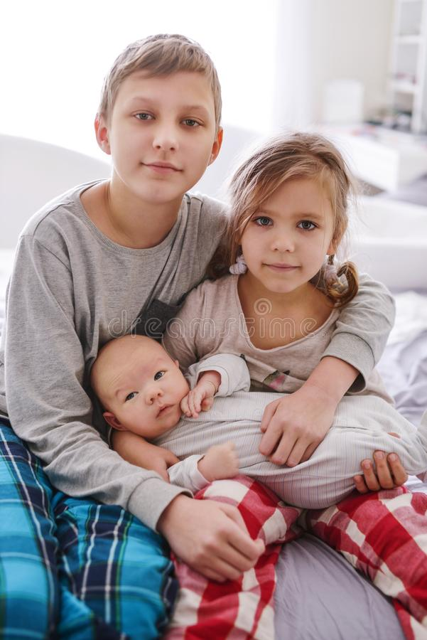 Three children at home royalty free stock photos