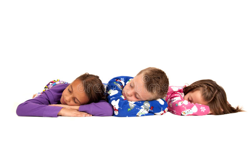 Download Three Children Laying Down In Their Warm Winter Pajamas Stock Image - Image: 35308181