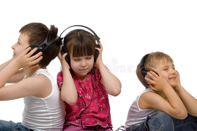 Three Children Listen to Music. Three children, two brothers and one sister, enjoying listening to their favorite music on headsets stock photos