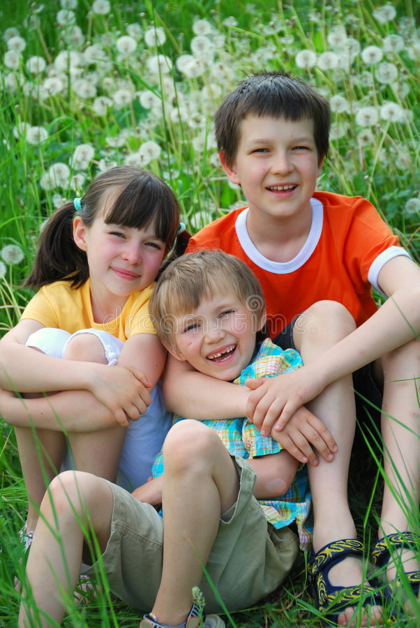 Three Children in Meadow