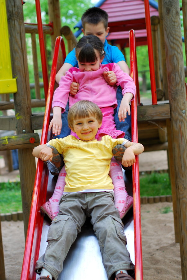 Free Three Children On Slide Stock Images - 2402454