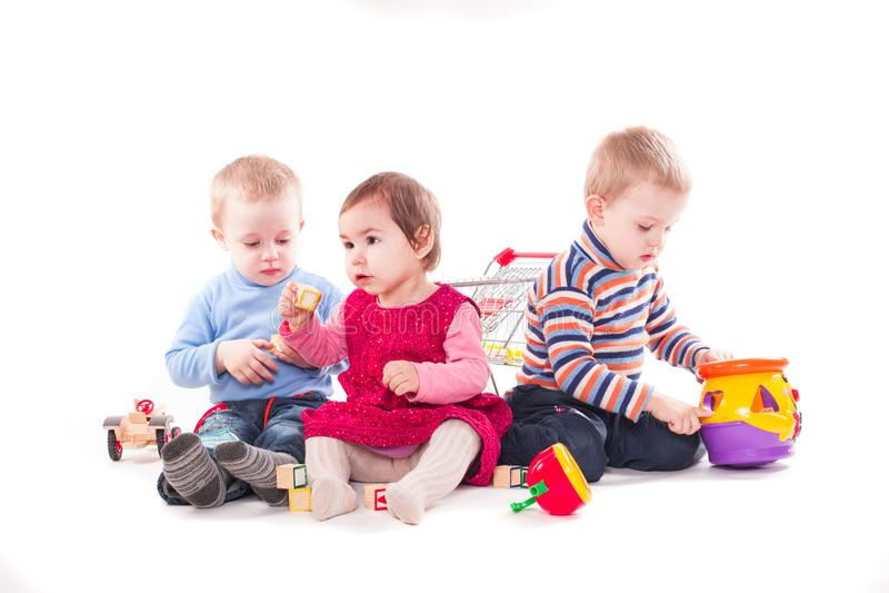 Three children play stock photos