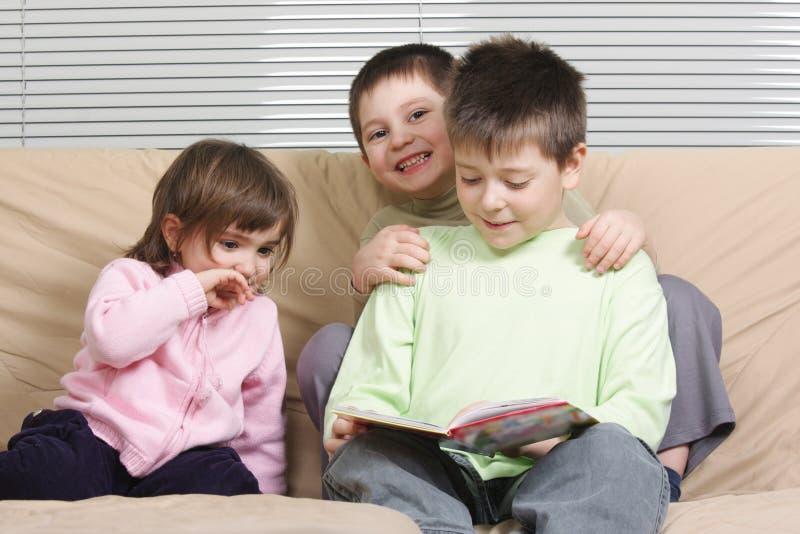 Download Three Children Reading Book Stock Photo - Image: 13635016