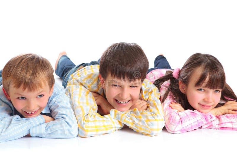 Three children smiling royalty free stock photos