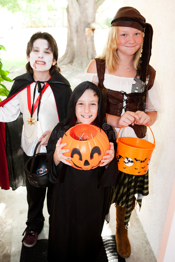 Download Three Children - Trick Or Treat Stock Photo - Image: 26916824