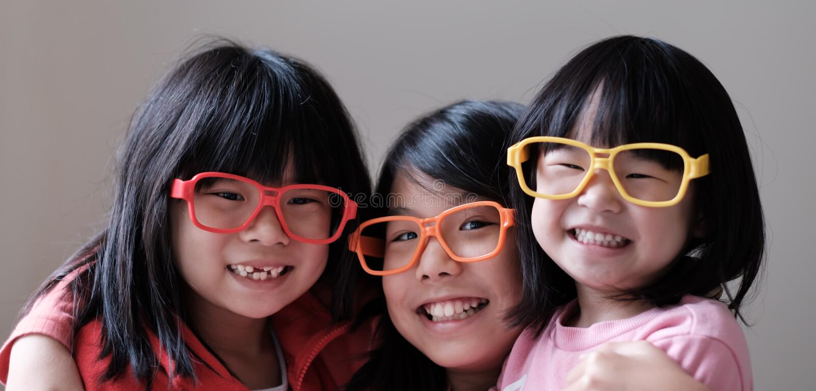 Three children wear big eyeglasses stock photography