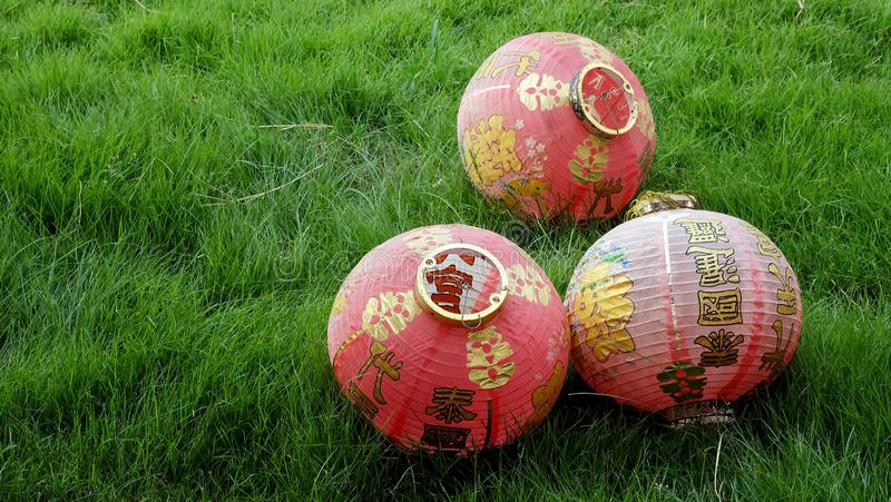 Three chinese lantern on green grass and have some space for write wording. Important symbolic of luck, happiness decorate in chinese temple especially for stock photography
