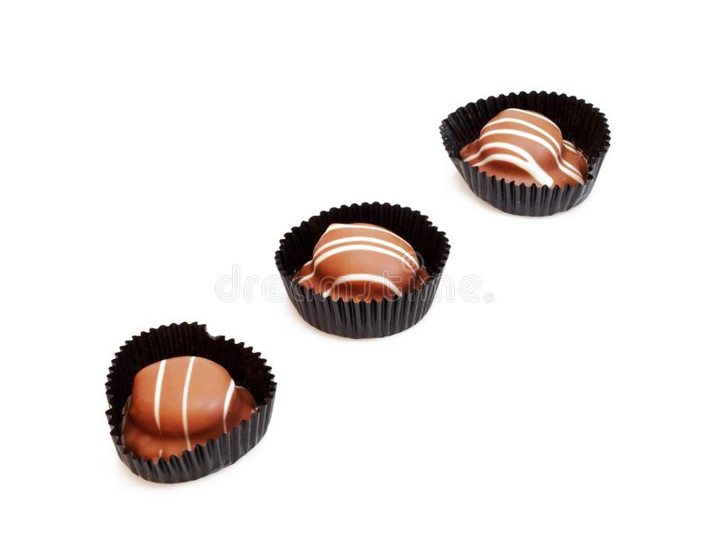 Three chocolate candies royalty free stock photo
