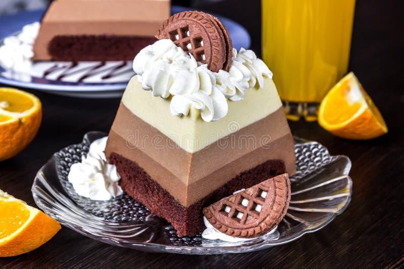 Three chocolates mousse cake slice.  stock photo