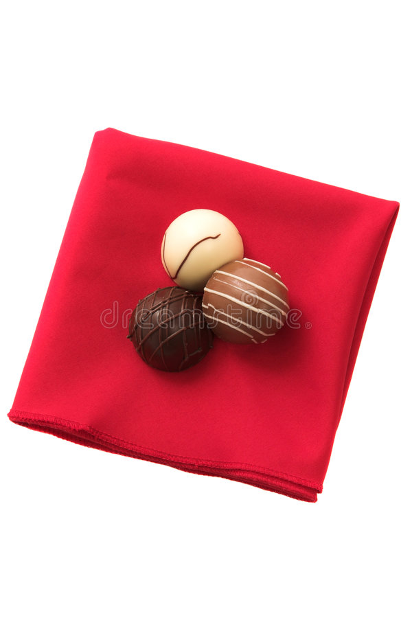 Download Three Chocolates On A Red Serviette Stock Photo - Image: 4268198