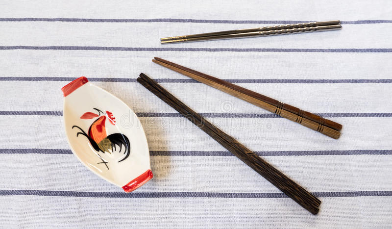 Three Chopsticks and Traditional Thai Chicken Bowl on White Table royalty free stock image