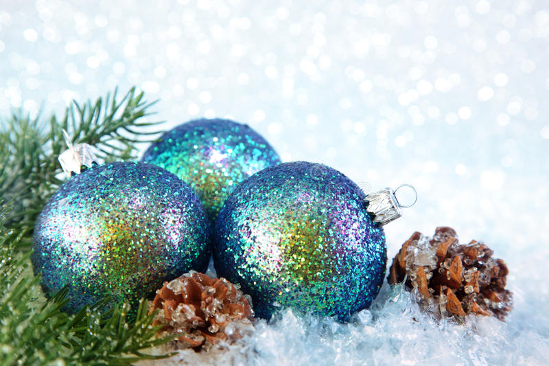 Three christmas balls. On snow background royalty free stock images