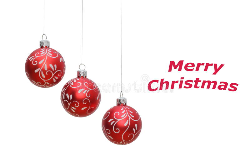 Three christmas balls isolated on white. Three hanging red christmas balls on white background, place for text royalty free stock photos
