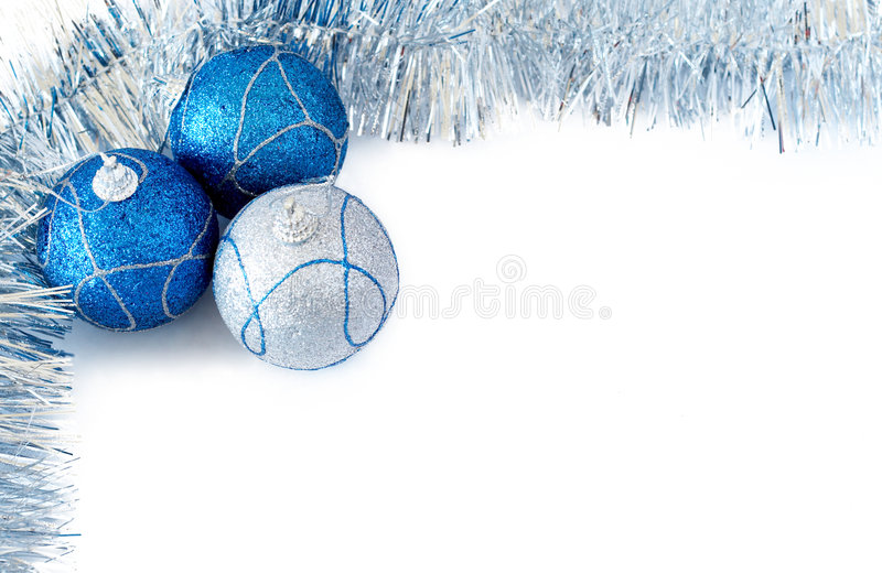 Three Christmas baubles with silver tinsel stock photo