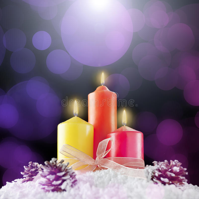 Download Three Christmas Candles In A Bokeh Background Stock Image - Image: 27527393