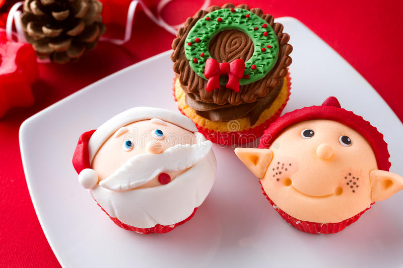 Three Christmas cupcakes stock images
