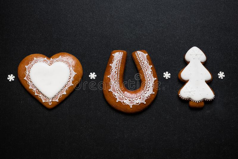 Three Christmas gingerbread cookies on black background stock images