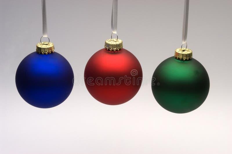 Three Christmas ornaments royalty free stock image