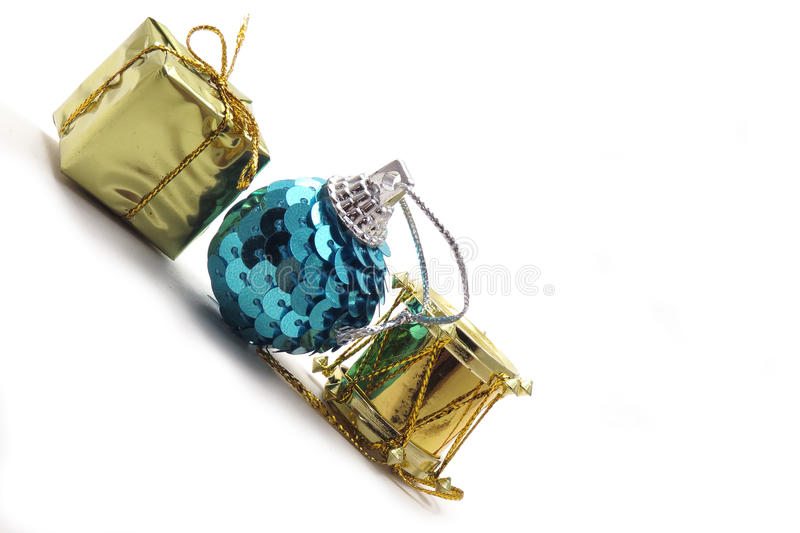 Three Christmas ornaments with copy space. Three Christmas ornaments, gift, present, sequin ball, and drum stock images