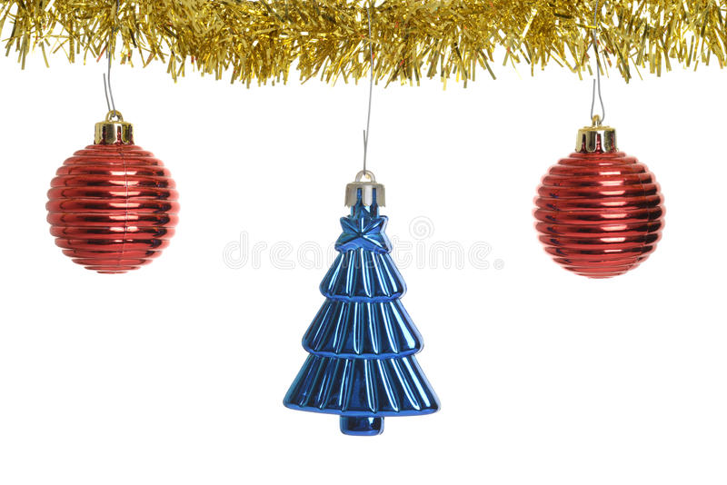 Three christmas ornaments on gold garland royalty free stock image