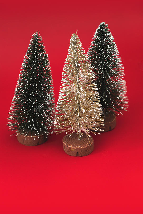 Three christmas trees on red background
