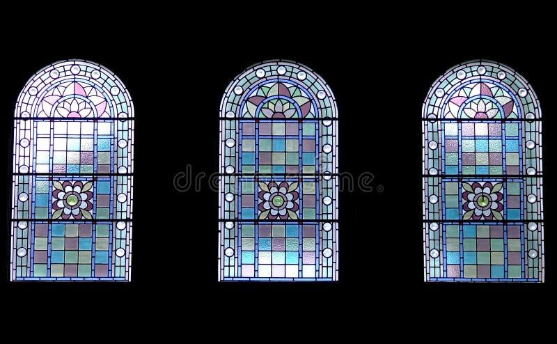 Three church windows royalty free stock photo