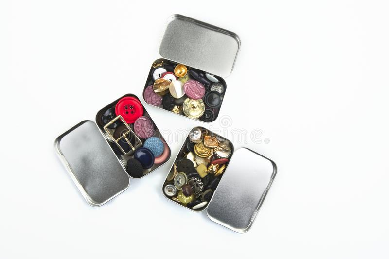 Three clothing buttons metal boxes collection. Pattern royalty free stock images