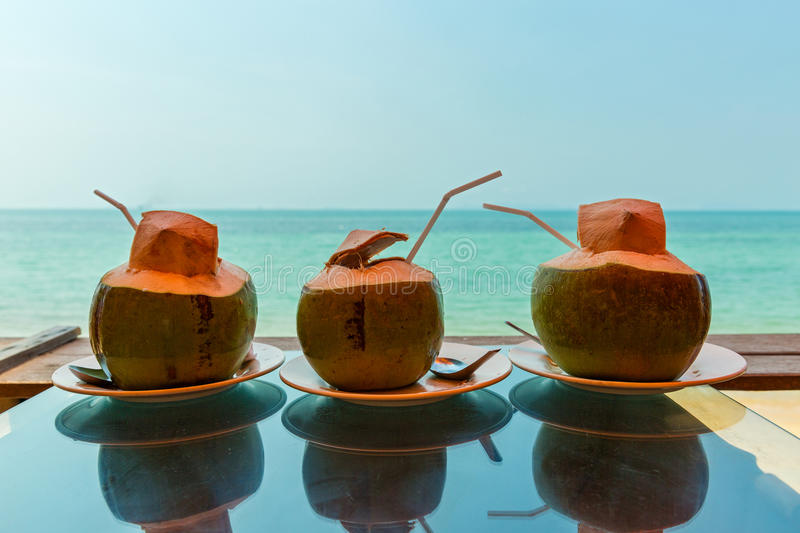 Three coconuts with fresh juice stock photo