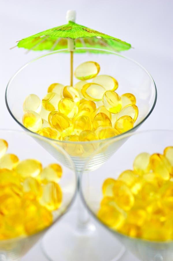 Three cod oil liver martinis stock image