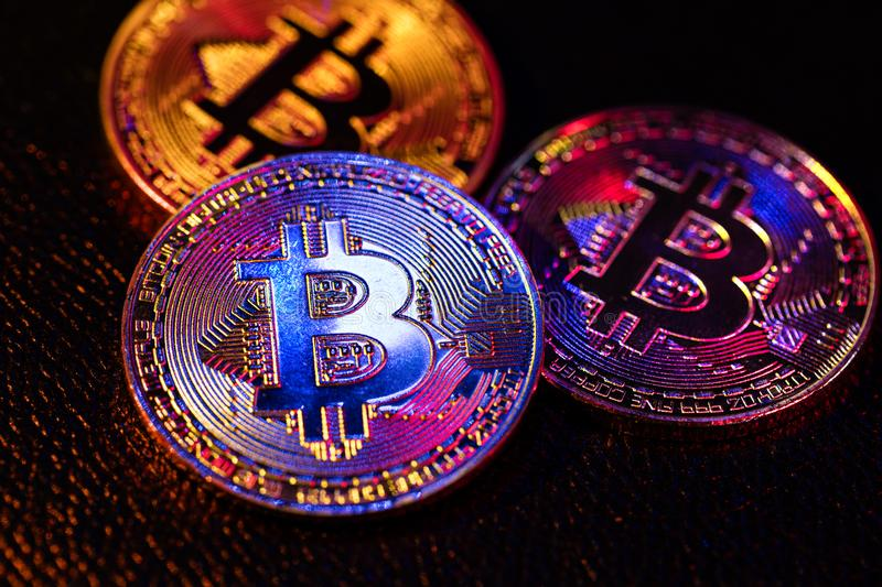 Three Coins With Bitcoin Logo Laying On A Black Background ...