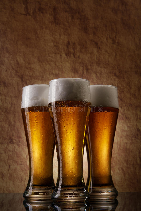 Free Three Cold Beer Into Glass On A Old Stone Royalty Free Stock Images - 21960369