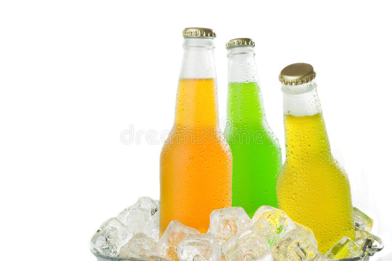 Three cold drinks in ice stock photography
