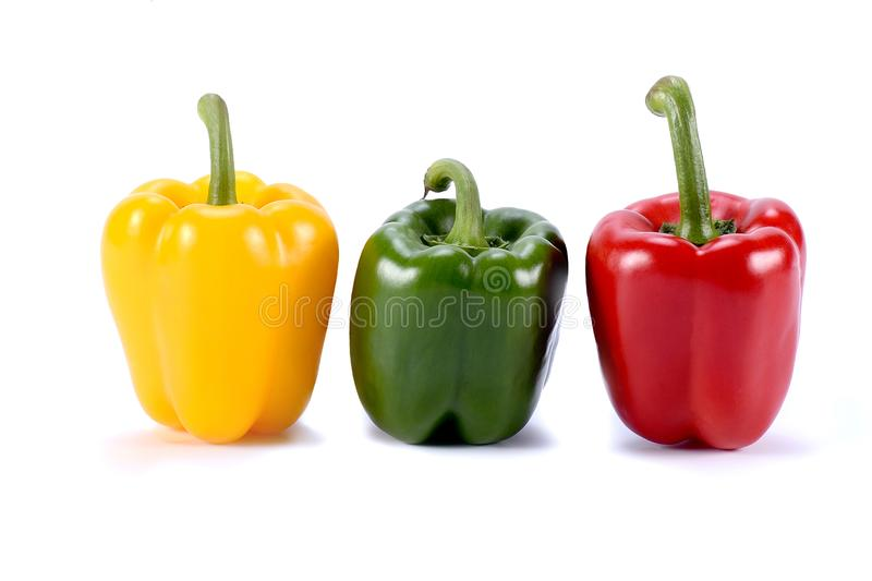 Three color sweet pepper Fresh vegetables Three sweet Red, Yellow, Green Peppers isolated on white background. royalty free stock photography