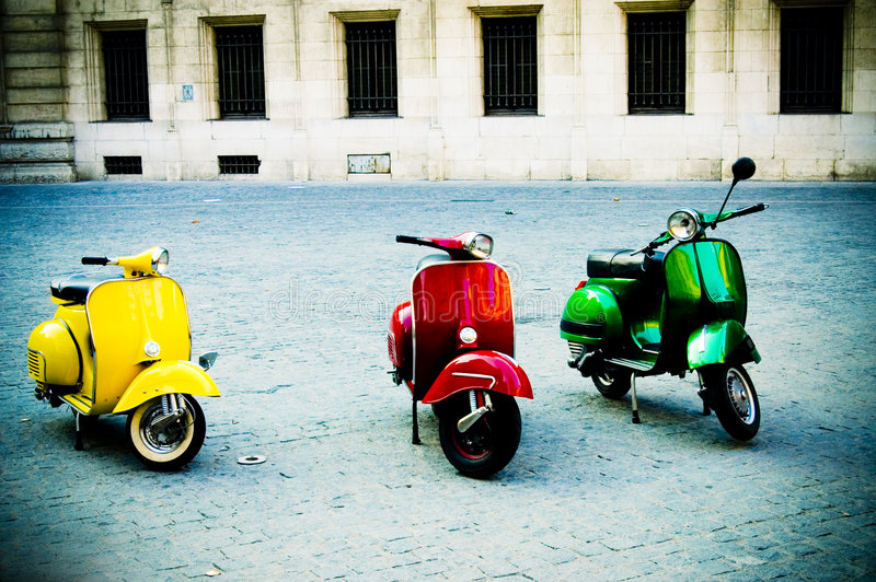 Three colored scooters plaza royalty free stock photography