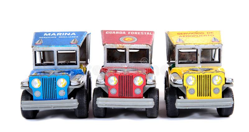 Three colored small offroad cars. Three small offroad cars on the white background royalty free stock images