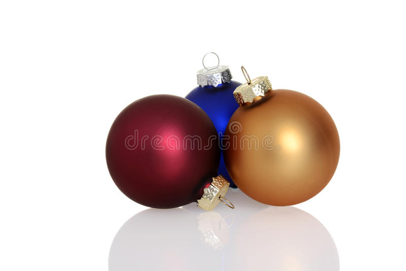 Three colorful christmas ornaments royalty free stock images