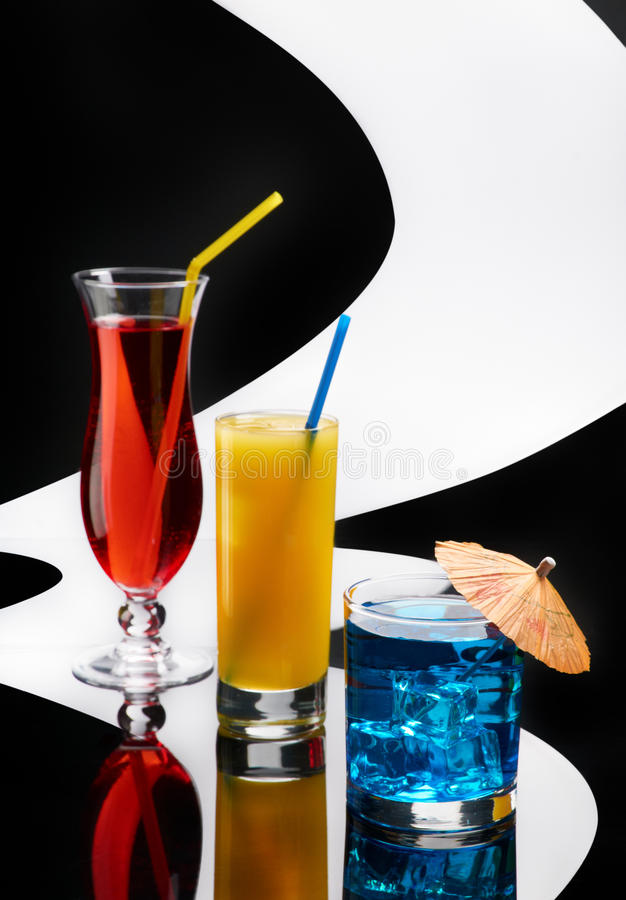 Three colorful cocktails. On conceptual background royalty free stock photo