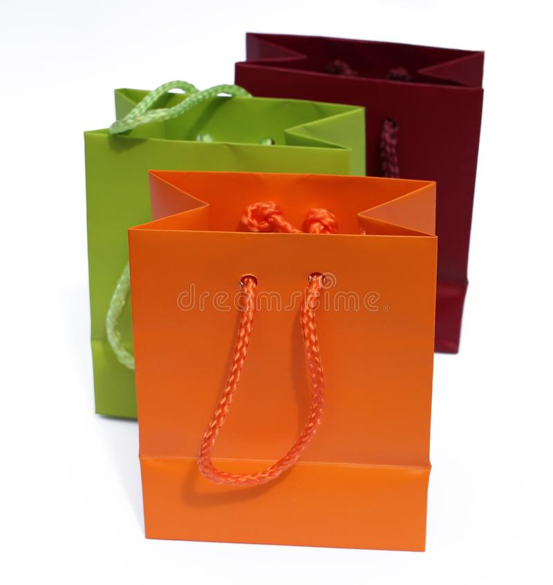Three colorful gift bags isolated on white background royalty free stock photos