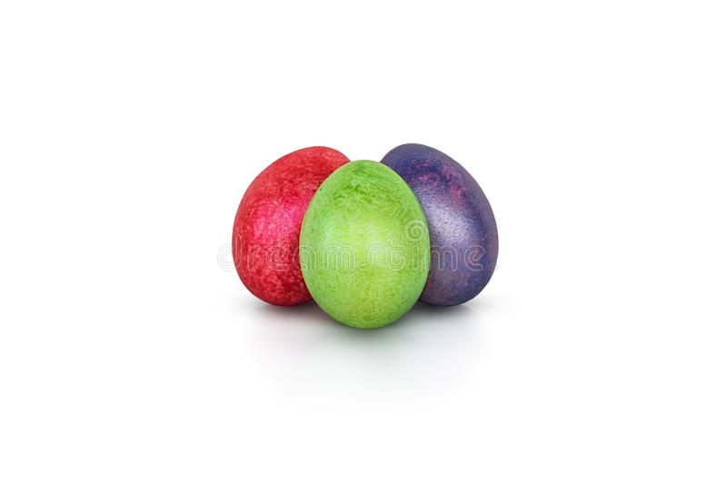 Three colorful handmade easter eggs on a white stock photos