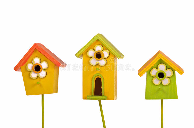 Three colorful starling-houses isolated stock photo