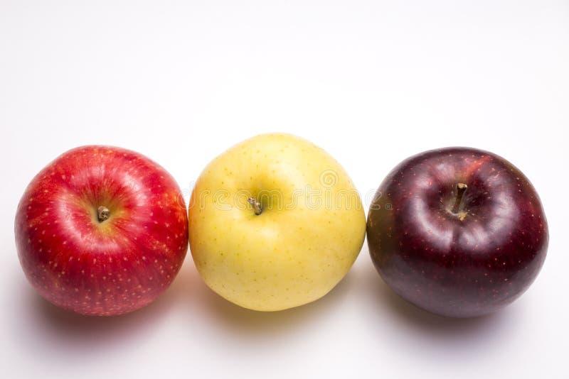 Three colors apples stock photos