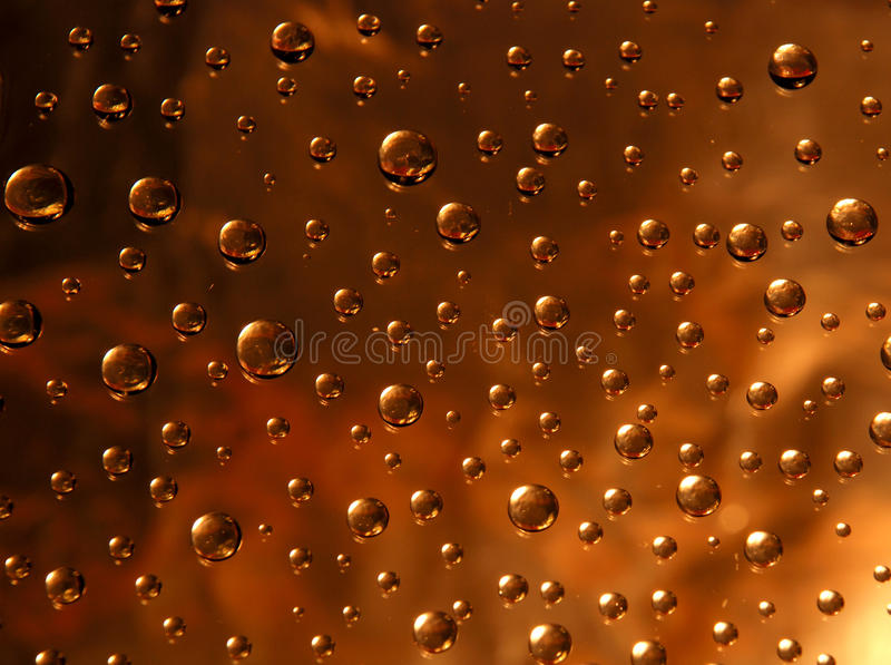 Three-coloured drops stock images