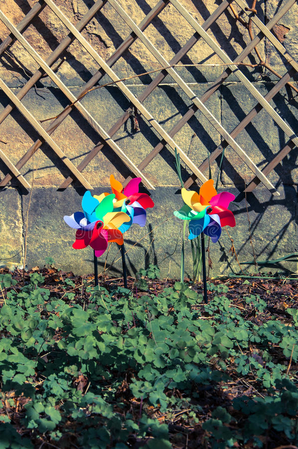 Download Three Coloured Pinwheels In A Garden Stock Image - Image: 39173577
